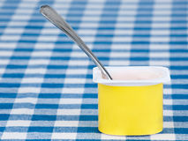 Yogurt pot with spoon Stock Image