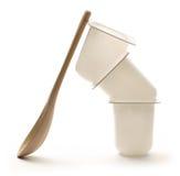 Yogurt pots with spoon Stock Photos