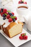 Yogurt pound cake with glaze and fresh berries Royalty Free Stock Photo