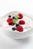 Yogurt with raspberries and blueberries Stock Photo