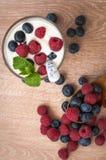 Yogurt with raspberries and blueberries Stock Photos