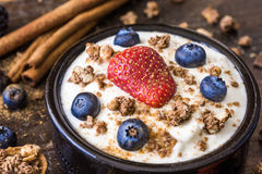 Yogurt with Raspberry, Blueberries and Muesli. Fresh White Yogurt with Raspberry, Blueberries and Muesli Stock Photo