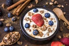 Yogurt with Raspberry, Blueberries and Muesli. Fresh White Yogurt with Raspberry, Blueberries and Muesli Stock Images