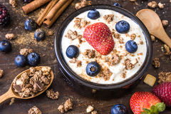 Yogurt with Raspberry, Blueberries and Muesli Royalty Free Stock Image