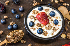 Yogurt with Raspberry, Blueberries and Muesli. Serving of Fresh White Yogurt with Raspberry, Blueberries and Muesli Royalty Free Stock Image