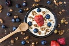 Yogurt with Raspberry, Blueberries and Muesli. Serving of Fresh White Yogurt with Raspberry, Blueberries and Muesli Stock Photos