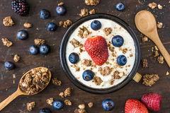 Yogurt with Raspberry, Blueberries and Muesli. Serving of Fresh White Yogurt with Raspberry, Blueberries and Muesli Royalty Free Stock Photos