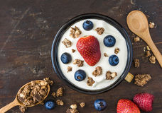 Yogurt with Raspberry, Blueberries and Muesli. Serving of Fresh White Yogurt with Raspberry, Blueberries and Muesli Stock Photography