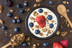 Yogurt with Raspberry, Blueberries and Muesli Royalty Free Stock Photos