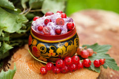 Yogurt with red currants in a bowl of Russian folk Stock Photo