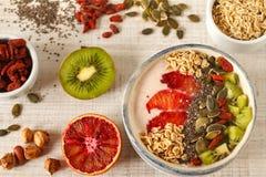 Yogurt with red orange, kiwi, chia seeds, nuts and oats Stock Image