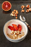 Yogurt with red orange, nuts and oats Stock Photography