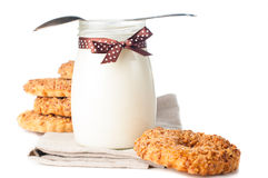Yogurt with a ribbon and nut cookies Stock Photos