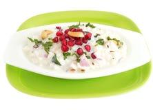 Yogurt rice. Garnished with pomegranate and cashew nuts Stock Photos