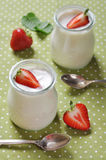 Yogurt with ripe fresh strawberry Royalty Free Stock Image