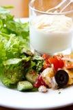 Yogurt and salad. Healthy breakfast with yogurt and green salad royalty free stock photo