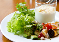 Yogurt and salad. Healthy breakfast with yogurt and green salad stock photos