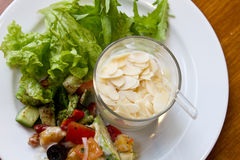 Yogurt and salad. Healthy breakfast with yogurt and green salad stock photo