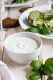 Yogurt sauce. For a green summer salad royalty free stock photo