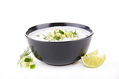 Yogurt sauce and herb. Isolated on white royalty free stock images
