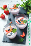 Yogurt smoothies with fresh fruits and berries stock photography