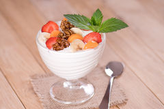 Yogurt with strawberries and banana carrot and walnuts Stock Images