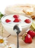 Yogurt with strawberries and flavored pancakes Stock Photo