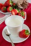 Yogurt with strawberries Stock Images