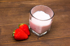 Yogurt with strawberries on wood from above Royalty Free Stock Image