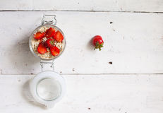 Yogurt with strawberries on the wooden table Stock Photo