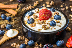 Yogurt with Strawberry, Blueberries and Muesli. Fresh White Yogurt with Strawberry, Blueberries and Muesli Stock Photo