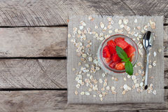 Yogurt with strawberry on wooden background top view Royalty Free Stock Photos