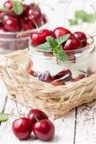 Yogurt with  sweet cherries Stock Photography
