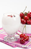 Yogurt and sweet cherry Royalty Free Stock Photos