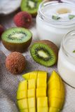Yogurt with tropical fruits Stock Images