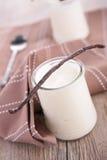Yogurt with vanilla stick Stock Photos