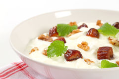 Yogurt with walnuts and dates Stock Images