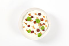 Yogurt with walnuts and dates Royalty Free Stock Images