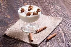 Yogurt with walnuts. Royalty Free Stock Photography