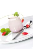 Yogurt and wild strawberries Stock Photos