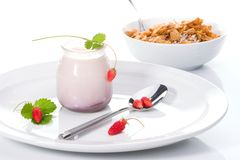 Yogurt, wild strawberries and Royalty Free Stock Images