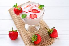 Free Yogurt With Fresh Red Strawberry On A Wooden Background Royalty Free Stock Photo - 118902025