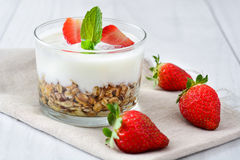 Yogurts with cereals and strawberries,breakfast Royalty Free Stock Photography