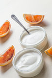 Yogurts or cosmetic cream assortment  in glass jar on ligth back Stock Photos