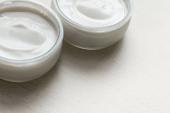 Yogurts or cosmetic cream assortment  in glass jar on ligth back Stock Image