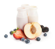 Yogurts and fruits Stock Image