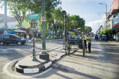 Horse carriage on the Malioboro street. Yogyakarta - Indonesia. April 10, 2018: Image of horse carriage and trishaw on the Malioboro street Stock Photos
