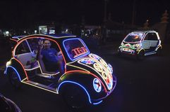 YOGYAKARTA, INDONESIA - JUNE 25, 2014: Undefined people having fun riding on the toy cars Royalty Free Stock Photos