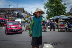 Yogyakarta, Indonesia - March 16, 2018: Elderly man on Malioboro Road in Yogyakarta. Yogyakarta, Indonesia - March 16, 2018: Elderly man on Malioboro Road in Royalty Free Stock Image
