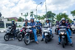 Yogyakarta, Indonesia - March 16, 2018: Scooter drivers waiting for the green light on Malioboro Road. Yogyakarta, Indonesia - March 16, 2018: Scooter drivers Stock Image